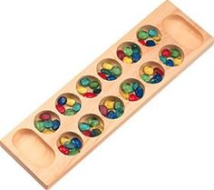 Mancala :: great age-appropriate fine motor play for older kids, turn-taking, social skills, counting and spatial orientation skills. My grandmother was the champ!