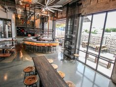 Founded by craft beer veteran and Magic Hat Brewing Company creator Alan Newman, this shiny brewery and beer hall in Wynwood is more polished than its local coh Brewery Decor, Brewery Interior, Brewery Restaurant, Beer Brewery, Bar Interior, Restaurant Design, Pub Design, Brewery Design, Hall Design