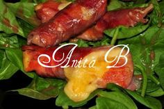 Scarsdale Diet Recipes: Cheese wrapped in Prosciutto on a bed of Spinach