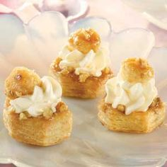 Mini puff pastry cups are brushed with a maple syrup mixture, baked until golden and filled with a sweetened whipped cream mixture. Serve them at your next party for a delicious dessert that will earn rave reviews. Comments