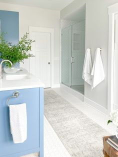 Primary bathroom design featuring classic and contemporary elements. The custom blue vanity including a linen closet is balanced by white quartz countertops, light gray walls, and white tile. #SherwinWilliamsReservedWhite #BenjaminMooreLazySunday #BlueBathroomVanity #PaintColor #LightGrayBathroomWallsWithBlueVanity #dbCPHistoricEdgefieldProject Guest Bathrooms, Rustic Bathrooms, Modern Bathroom Decor, Bathroom Interior Design, Blue Bathroom Vanity, Blue Vanity, Light Grey Walls, Gray Walls, Diy Furniture Projects