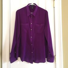 Beautiful Flowy Purple Button Down This beautiful purple Lauren by Ralph Lauren button down blouse has two front pockets and is perfect for work with your favorite pencil skirt or pair with dark jeans for your next happy hour. Material: 95% Polyester, 5% Elastane. Ralph Lauren Tops Button Down Shirts