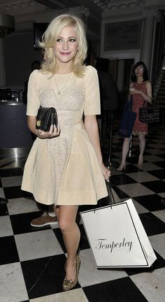 We adore Pixie Lott's pretty creme colored babydoll dress and her cute leopard heels!