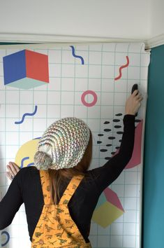 How to Hang a Wall Mural on th blog! Don't you just love the 80s design of this memphis pattern?