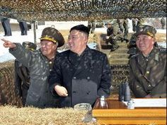 Military threats ... Kim Jong-un inspects a live fire drill using self-propelled drones a