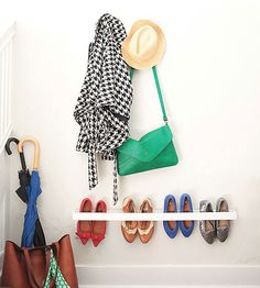"Leave it to Emily Henderson to devise a DIY shoe organizer that's simple, functional, and -- in her own witty words -- ""inoffensive."" The stylist and blogger built this wall-hanging storage piece to keep flat-soled shoes off the ground. Emily spray-painted her shoe organizer white, but you could match yours to your entryway walls for a similar minimalistic look."