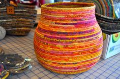Wow! Look at those colors!!!   Fabric Wrapped over clothesline baskets