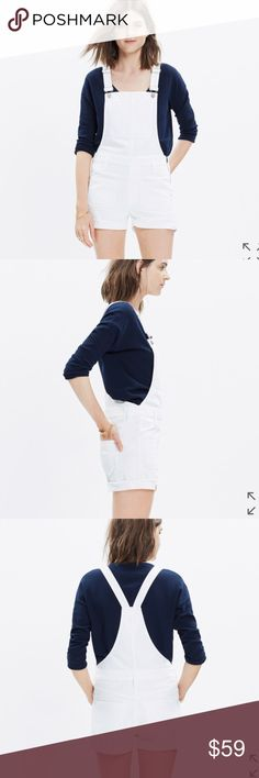 """Madewall Adirondack White Overalls Bib overalls meet jean shorts in this warm-weather version of our favorite one-piece. Frayed hems give these white denim shortalls that had-them-since-high-school look (patch pockets and all).    100% premium cotton denim. Specially woven to counteract the whole show-through factor. Matte silver hardware, side zip, tonal stitching. True to size. 3"""" inseam. Machine wash. Madewell Shorts"""