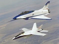Aircraft Fleet 1990s    One of two X-31 Enhanced Fighter Maneuverability Demonstrator aircraft (top), flown by an international test organization at NASA's Dryden Flight Research Center, Edwards, California, is seen here accompanied by a NASA F-18 chase aircraft during a research flight over the desert floor. The X-31 had a three-axis thrust-vectoring system, coupled with advanced flight controls, to allow it to maneuver tightly at very high angles of attack.    1994, NASA Photo / NASA