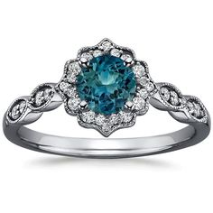 =o. This ring! And the stone color. Luv!  It needs to be in white gold though.. ? 18K White Gold Sapphire Black Rhodium Cadenza Halo Diamond Ring, top view