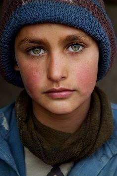 """Pashtun refugee boy in Kabul"". This photo shows a young Pashtun boy in a refugee camp in Kabul, Afghanistan. What a handsome boy with such beautiful eyes! (Photo by Christina Feldt for the National Geographic). National Geographic Photo Contest, National Geographic People, National Geographic Photography, Eye Photography, Children Photography, Foto Art, Interesting Faces, World Cultures, People Around The World"