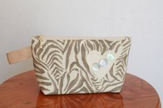 Heart and Zebra Print Cosmetic Purse with mother-of-pearl buttons by EverSewNice on Etsy
