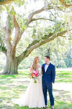 Blush Lace Essense of Australia Gown and Navy Blue Suit | Colorful Old Wide Awake Plantation Wedding by Charleston wedding photographer Dana Cubbage Weddings