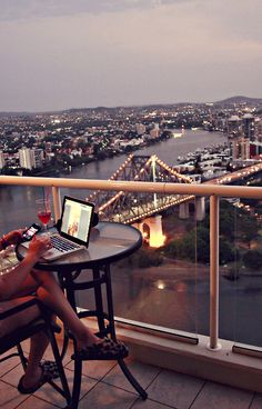 A balcony at dusk, a laptop, and cozy slippers. What more could a writer want?