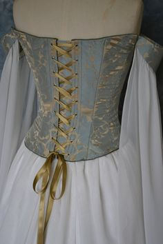 Beth, a truly elegant, flowing medieval, elvish inspired corseted wedding gown. The corseted bodice and removable flowing sleeves are made from duck