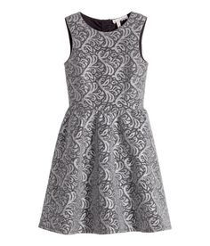 Glittery silver sleeveless dress with jacquard pattern, cut-out back panels, and gently flared skirt. | Party in H&M