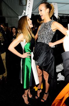 Supermodel Karlie Kloss towered over Hilary Swank backstage at the Michael Kors Fall 2013 Fashion Show during New York Fashion Week Feb. 13.