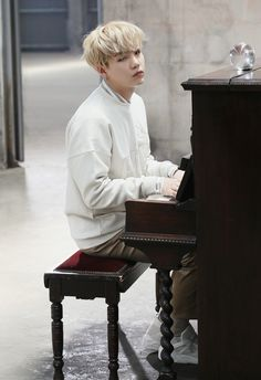 Suga ❤ (I've been waiting for a photo like this of Yoongi playing the piano! Thx…