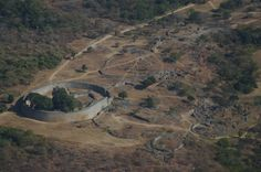 Aerial view of Great Enclosure and Valley Complex, looking west |   Janice Bell - Own work | Great Zimbabwe is a ruined city in the south-eastern hills of Zimbabwe near Lake Mutirikwe and the town of Masvingo. It was the capital of the Kingdom of Zimbabwe during the country's Late Iron Age. Construction on the monument began in the 11th century and continued until the 15th century.[2][3] The most widely-accepted modern archaeological theory is that the edifices were erected by the ancestral…