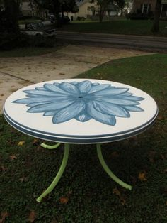Hand-painted patio table salvaged from the dumpster, using Annie Sloan…