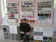 Work space - Scrapbook.com - Great craft studio. Totally organized and a great idea to use inexpensive flowerpots to keep markers, etc. handy. #craftstudio #scrapbooking