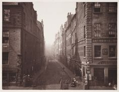Bell Street, From High Street, Glasgow, 1868    The building on the right is an Undertaker's, I think. James Howie.  Having never been to Glasgow, I'd be interested to hear from someone who has whether any of the scenes in Annan's photographs are still recogn