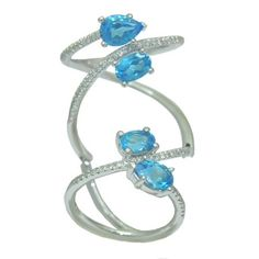 Blue Topaz Ring with 0.33 Cttw. Diamonds https://www.goldinart.com/shop/rings/colored-gemstone-rings/blue-topaz-ring-with-0-33-cttw-diamonds #14KaratWhiteGold, #BlueTopaz