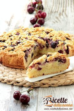 Crumbled Tart with Cream,mascarpone cheese and Cherries.This cake is inspired by the famous Sbrisolona Valance .