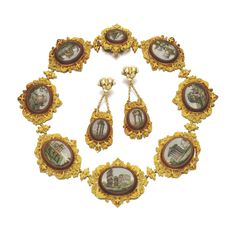 GOLD AND MICROMOSAIC DEMI-PARURE, 1820S Comprising: a necklace designed as a series of eight  graduated micromosaic oval plaques, depicting the principle sights of Rome...together with a pair of earrings depicting the Temple of Vespasian and Castor and Pollux, each mounted within gold cannetille frames