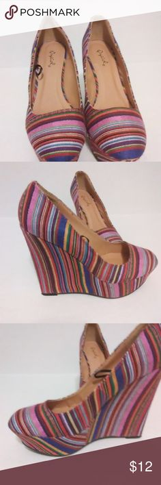Qupid Platform Wedge Heel Shoe Qupid brand canvas multi-color stripe shoe with a 5 1/2 inch wedge heel and 1 1/2 inch platform will give a basic outfit that pop of color needed to stand out.  This brand is typically sold at trendy lower-end retail stores. Qupid Shoes Wedges