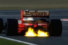 Ayrton Senna's Honda powered McLaren spits flames on downshift during the 1992 Formula 1 Grand Prix season. F1 Wallpaper Hd, Car Wallpapers, Ayrton Senna Quotes, Trivia, Mclaren Formula 1, Aryton Senna, San Marino Grand Prix, Mclaren Mp4, Thing 1