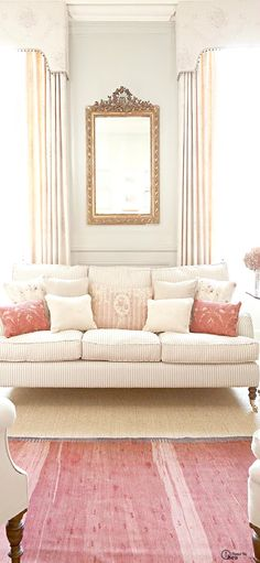 Pretty living room colors, cream white pink salmon draperies, furniture and rug :)