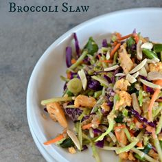 Asian Quinoa Broccoli Slaw Recipe Salads with broccoli slaw, red cabbage, cauliflower, snow peas, scallions, quinoa, slivered almonds, orange juice, lime juice, tamari soy sauce, rice vinegar, brown sugar, sesame oil, vegetable oil, salt, pepper
