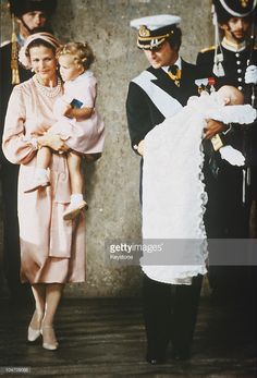 Queen Silvia and King Carl Gustav XVI of Sweden with Princess Victoria and baby Prince Carl Philip during his christening held at the Royal Chapel in Stockholm on August 31, 1979.