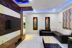Design was done keeping in the mind status of the owner Shri Raghunanda rao (ceo of NCL HOMES a corporate builder ) owner 's requirement was to have simple interiors with white ,brown and beige combinations and there preference was to have lot greenery inside the house. by Pavan Kakade