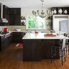 Direct Traffic  For kid-friendly kitchen designs, keep the cooktop out of traffic areas so children don't catch handles and cause spills when running through. Also, make the refrigerator accessible to both passersby and people working in cooking and cleanup areas.