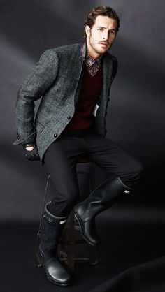 Shop this look on Lookastic:  http://lookastic.com/men/looks/rain-boots-chinos-gloves-blazer-v-neck-sweater-longsleeve-shirt/6789  — Black Rain Boots  — Black Chinos  — Black Leather Gloves  — Charcoal Check Wool Blazer  — Burgundy V-neck Sweater  — Burgundy Print Long Sleeve Shirt