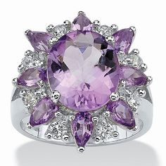 A fabulous gathering of amethyst and white topaz enriches a ring with 6.70 carats T.W. of gemstones. Decorating your fiPrice - $79-oxbZcvJM