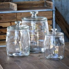 Glass Jars with Lids                                What a delightful cookie jar or flour canister a Glass Jar with Lid would make. A glass jar is reminiscent of the country store counter jars that were displayed on the counter and held salted peanuts, candy or pickles. A glass lid keeps the items covered and a round glass knob serves as the handle. Sold separately in 3 different sizes, or get one of each size in a set.