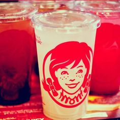 """Photo by: Wendy's via Facebook """"Look at the clever way the word Mom is hidden in Wendy's collar,"""" noted Stocklogos. """"The trick is most apparent in the single color variation of the logo used on packaging."""" Like this all-red example on a plastic cup."""