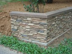 A retired contractor built this stacked stone retaining wall with faux panels to match the southwestern look of his home. Concrete Patios, Concrete Wall, Brick Wall, Stamped Concrete, Concrete Front Porch, Concrete Backyard, Brick Fence, Pallet Fence, Rock Retaining Wall
