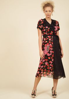 <p>This black wrap dress by Anna Sui meets at the intersection of luxurious and lighthearted - your two favorite design perspectives! Tulip-style sleeves and a ruffled neckline offer classic, feminine touches to this silk midi, while its red-and-pink heart print and metallic gold stars imbue your look with upbeat personality.</p>