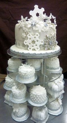 So wintery and pretty, really like the use of silver snowflakes and the cupcakes look like little wedding cakes!