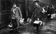 Two soldiers at Victoria station, London about to leave for the front line. They are carrying food and provisions in parcels, 1914 Hulton