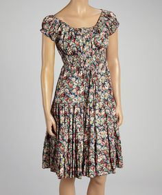 This Navy & Pink Floral Smocked Cap-Sleeve Dress by Aryeh is perfect! #zulilyfinds