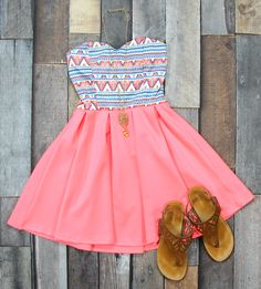 We think this Neon Aztec Party Dress is adorable! Get yours at Entourage for just $38!