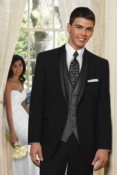 A satin shawl lapel with an embroidered braid and satin-covered buttons are subtle details that make the Black El Rey tuxedo a contemporary choice for your next formal event. Tailored in 100% worsted