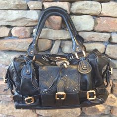 """Chloe Paddington Black with Gold Hardware EUC Clean. Smoke free. No damage. Only normal wear. See additional listings for more pictures and close ups of wear. Posh checkout only. I don't do payment plans or email additional pics. I don't sell on other websites. I'll answer all questions here. I'll consider trading for certain Balanciagas with drama free Poshers with good histories. 14"""" wide, 8"""" tall, 6"""" deep. Reasonable private offers considered. Others ignored. The packing of this item will…"""