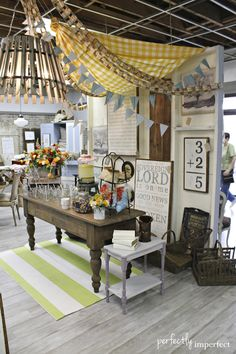 "perfectly imperfects vintage market | shop styling...""tent"" made of a draped bedspread, pennants + paper chains"