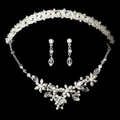This stunning bridal tiara and jewellery set features all things that glitter and will definitely make you feel extra fabulous on your special day. The lovely bridal tiara and necklace in this set features sprigs of dazzling clear Swarovski crystals and sparkling clear round rhinestones elegantly strung on delicate silver wire.
